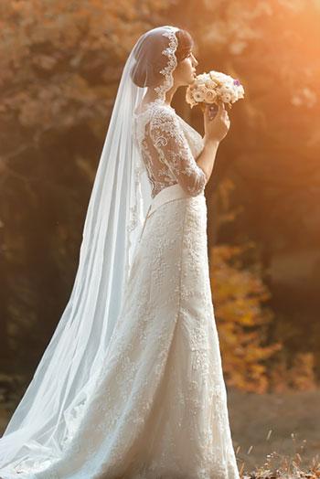 bride in white gown with flowers
